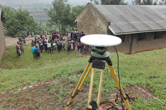 A local community observes Fugro's surveying in action