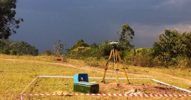 Field reconnaissance as a storm builds in the distance