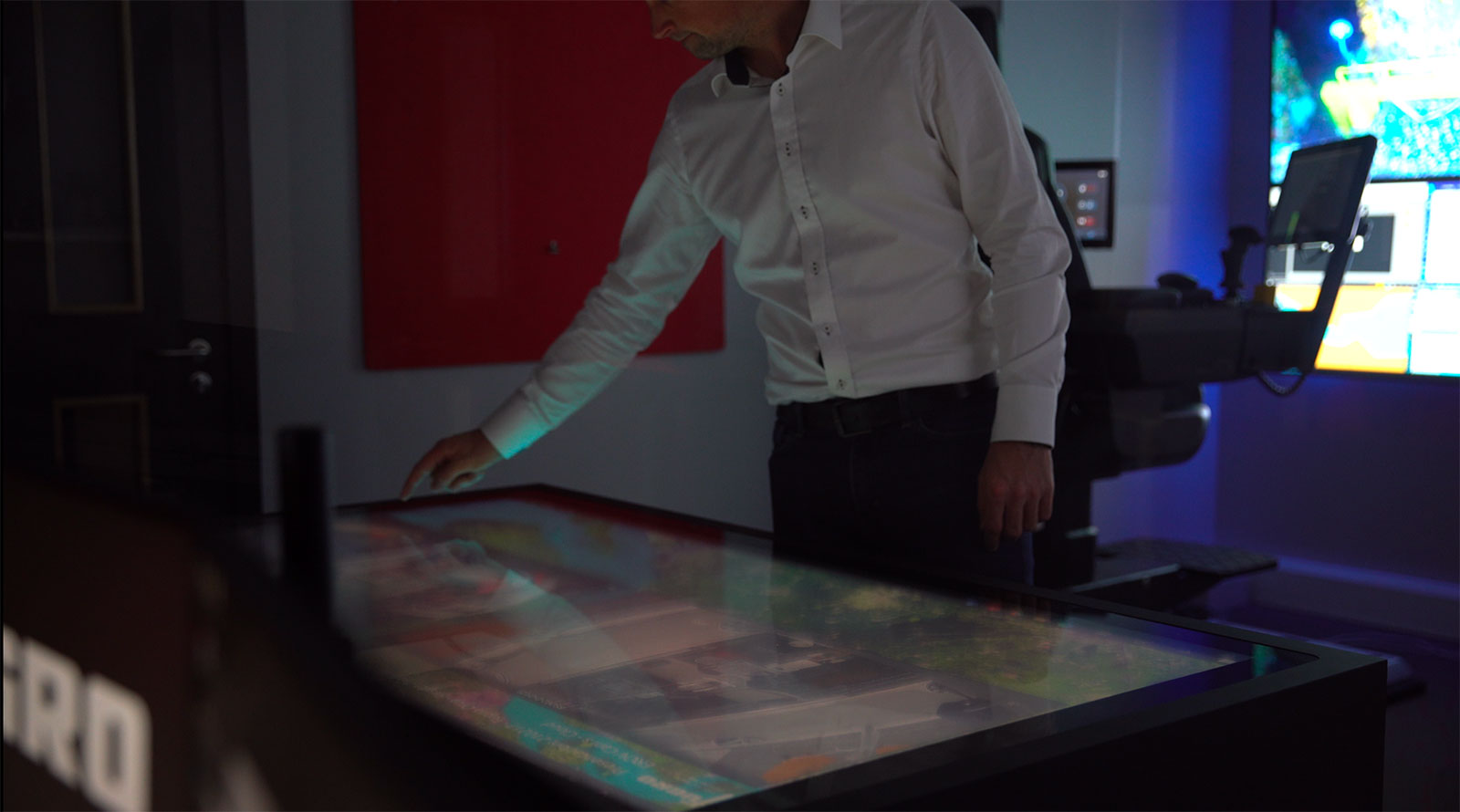Uncrewed-surface-vessel-passage-planning-being-conducted-on-Fugros-digital-touch-table-within-our-Aberdeen-ROC
