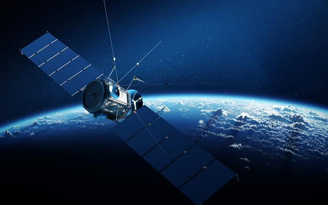 Communications satellite orbiting earth