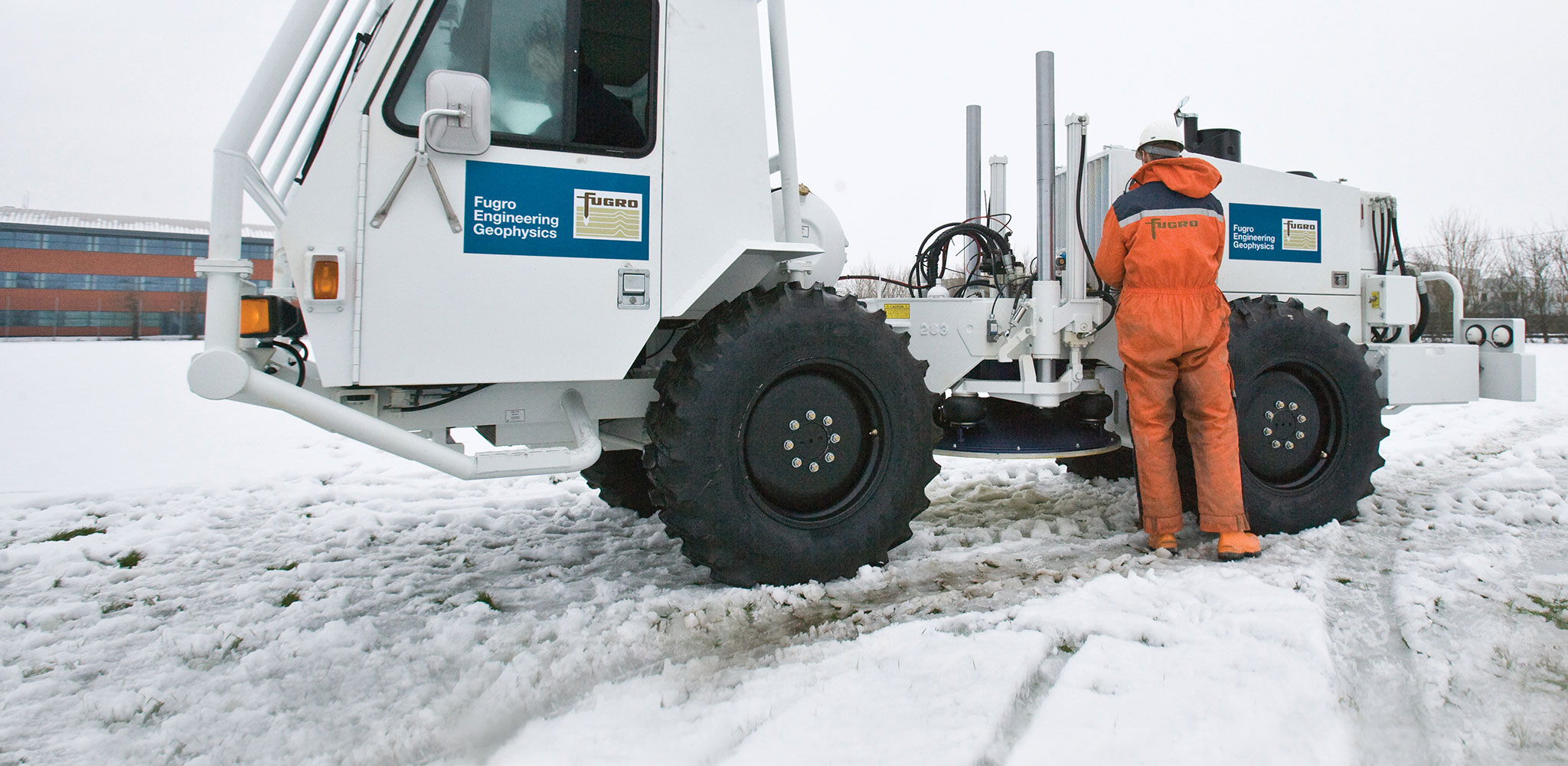 A Fugro Engineering Geophysics engineer prepares to conduct a geophysical survey at a cold-climate site